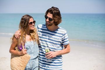 Happy couple standing on shore