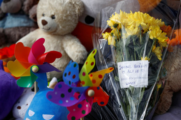 Flowers, candles and childrens' toys left as a memorial to Alfie Evans, the 23-month-old toddler who died a week after his life support was withdrawn, are seen outside Alder Hey Children's Hospital in Liverpool