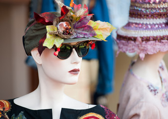 Stand with mannequin in vintage floral hat.