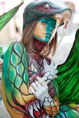 Beautiful woman with fully painted body. Body painting technique..