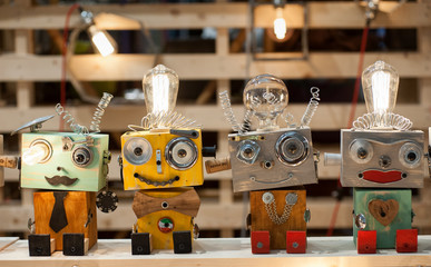 Puppets built with recycled materials on a toy stand