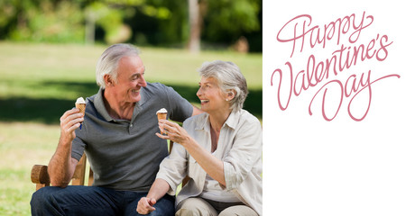 Senior couple eating an ice cream on a bench against cute valentines message