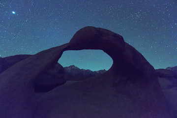Arch and starrry skies in the Eastern Sierra Mountains, California, USA.
