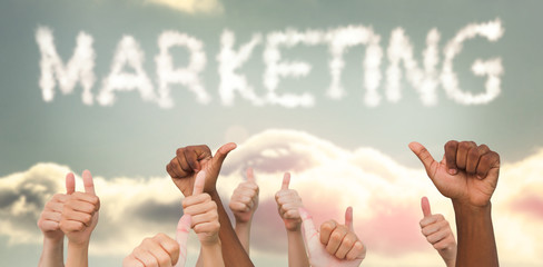 Hands giving thumbs up  against clouds spelling out marketing