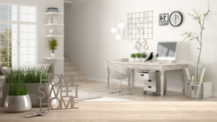 Wooden table, desk or shelf with potted grass plant, house keys and 3D letters making the words home sweet home, over home workplace, architecture interior design, copy space background