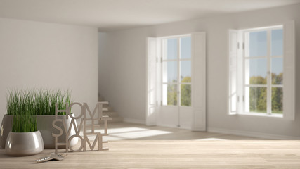 Wooden table, desk or shelf with potted grass plant, house keys and 3D letters making the words home sweet home, over scandinavian empty space, architecture interior design, copy space background