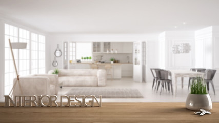 Wooden table, desk or shelf with potted grass plant, house keys and 3D letters making the words interior design, over blurred scandinavian living room, project concept copy space background
