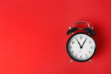 Alarm clock on color background. Time change concept