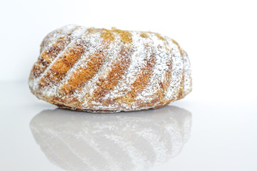 A Gugelhupf is a yeast based cake, traditionally baked in a distinctive circular Bundt mold
