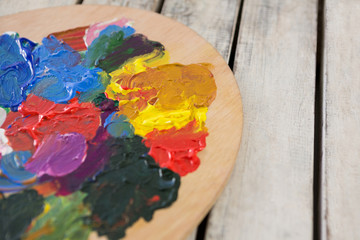 Wooden palette with various watercolor