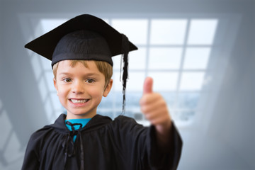Cute pupil in graduation robe against room with large windows showing city