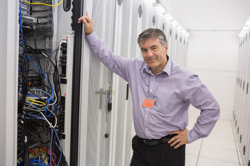Technician leaning against server