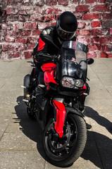 Brutal motorcyclist on a super bike