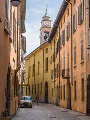 colored facades in a quiet street of Como without car traffic.Italy