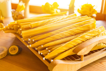 Lot of natural beeswax candles in small store