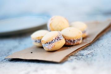Delicious Argentinian Alfajores Maicena cookies con Dulce de Leche on Paperback, Close-Up