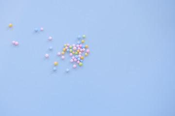 multicolored foam balls on blue background