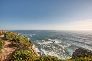 Exploring Portugal. Cabo da Roca ocean and mountains view landscape, authentic capture, wanderlust concept.