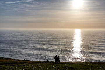 Exploring Portugal. Cabo da Roca ocean and mountains view landscape, authentic capture, wanderlust concept. sunset silhouettes