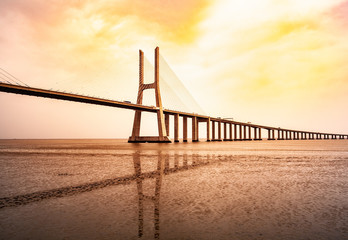 The Vasco da Gama Bridge in Lisbon, Portugal in a summer day. beautiful colors