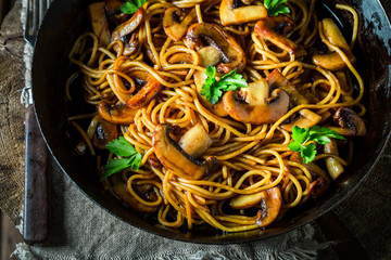 Yummy homemade spaghetti with mushrooms and parsley