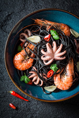 Delicious seafood black pasta made of tiger prawns and octopus