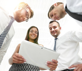 bottom view of business team looking at digital tablet