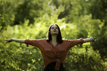 Carefree girl reaching to the sky