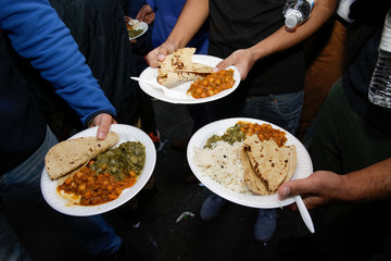 Free vegetarian meals are shown for the camera by participants at the Annual Sikh Day Parade in Manhattan, New York