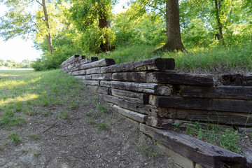 A wall of wood in a city park on a sunny spring day in Texas