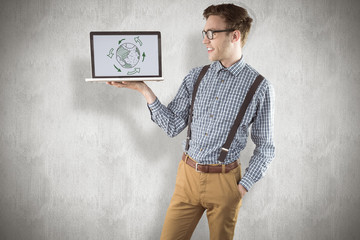 Geeky businessman showing his laptop against white background