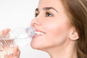 Woman drinks water from the bottle