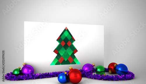 hipster christmas tree against poster with colourful christmas