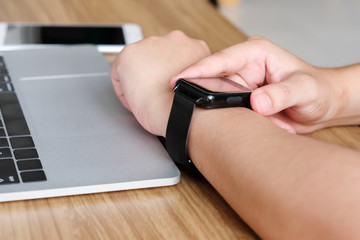 Man hand touching smartwatch, technology lifestyle concept