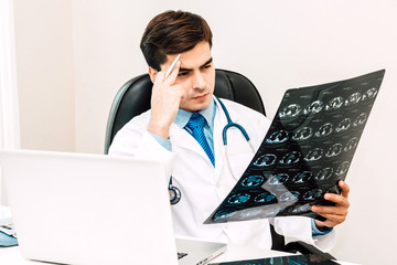 Doctor looking at x-ray photo in hospital.healthcare and medicine