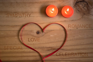 Red ribbon heart on wooden background, Valentines day concepts
