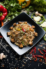noodle fried tofu and vegetable on a plate. traditional asian cuisine food preparing craft