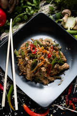 rice noodle pork and vegetable dish recipe. meal food ingredients and cooking process. asian cuisine