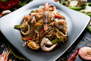 asian cuisine. healthy nutrition. wholesome food diet. noodle prawn shrimp seafood and vegetable dish