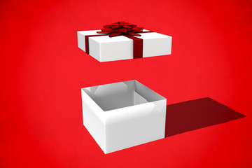 White and red gift box against red background