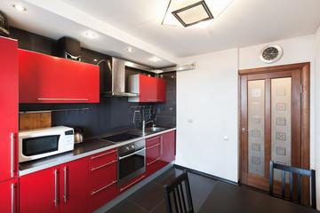 Kitchen interior. Black, red and white design
