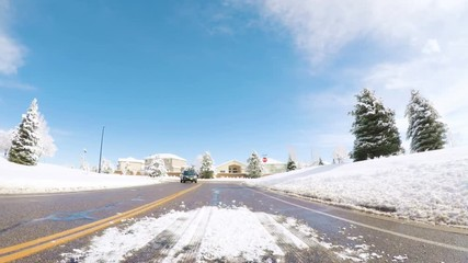 Wall Mural - Denver, Colorado, USA-March 27, 2018-POV-Driving on suburban road after the Sping snow storm