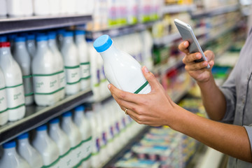 Woman taking picture of some milk