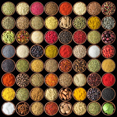 Fototapete - Spices and herbs isolated on black background. Various spices for food