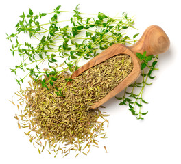 dried thyme leaves in the wooden scoop, with fresh thyme, isolated on white, top view