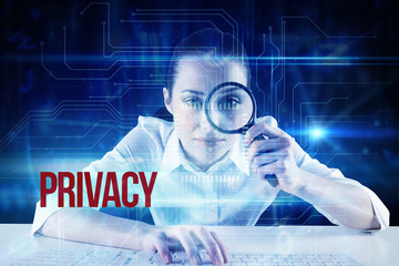 The word privacy and businesswoman typing and looking through magnifying glass against blue technology interface with circuit board