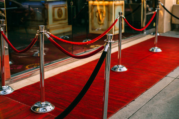 red carpet entrance with golden stanchions and ropes. event party.