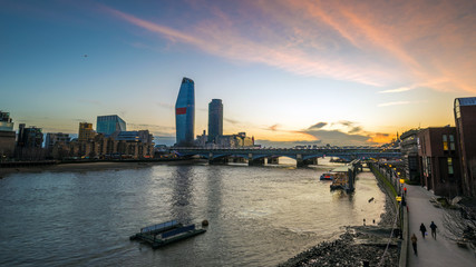 London, England - Beautiful sunset in London with skyscrapers and Blackfriars Bridge over River Thames