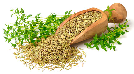 dried thyme leaves in the wooden scoop, with fresh thyme, isolated on white
