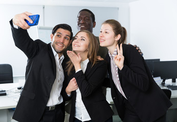 International business group making selfie with phone
